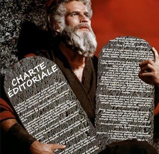Moïse tient la charte éditoriale gravée sur des tables de la loi