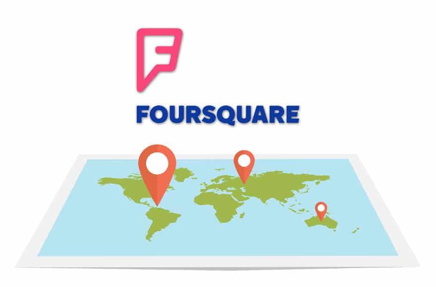 Le logo Foursquare avec un map du monde sur une tablette